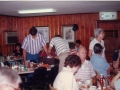 Mike and Lanier Hickman cleaning a table, with Doris Cook to the right