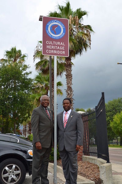 ~South Carolina Congressman James Clyburn (L) and Jacksonville, FL Mayor Alvin Brown (R) standing by a new Gullah Geechee Cultural Heritage Corridor sign in Jacksonville, FL~