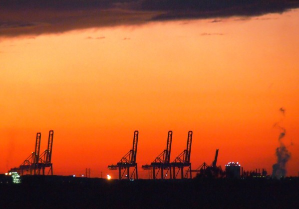 Savannah, GA Port cranes at sunset - photograph taken from alongside Highway 17